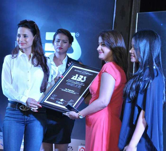 Awarded as Best Makeup Artist. Receiving Award from Ameesha Patel
