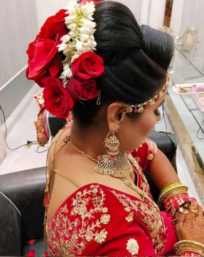 Floral Bun for Brides by Bridal Makeup Artist in Seelampur